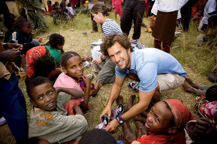Mycoskie on a 'shoe drop' to Ethiopa in 2010. Image credit: Kwaku Alston/Courtesy Company/Inc